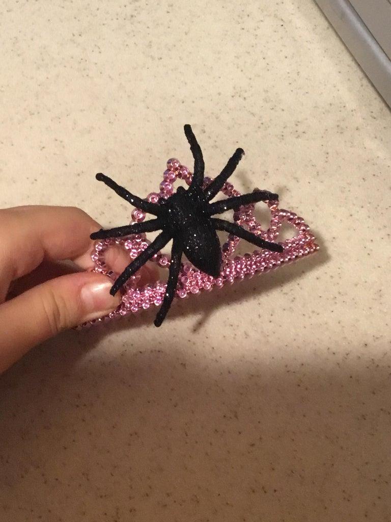 Hot Glue a Plastic Spider Onto the Princess Crown