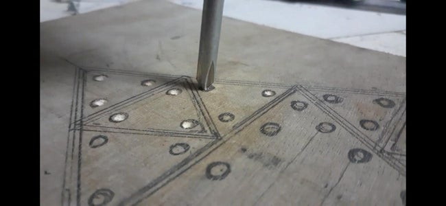 DENTING AND DRILLING THE HOLES