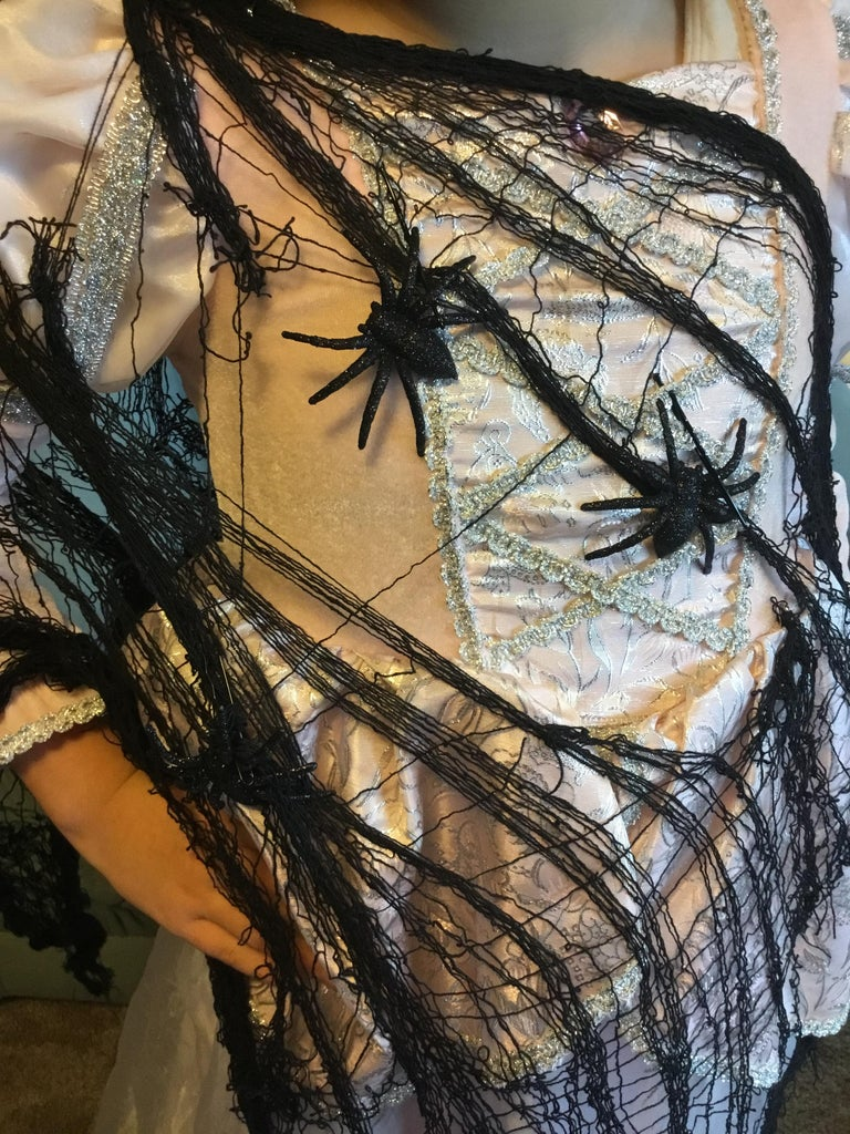 Secure a Few Plastic Spiders Onto the Black Mesh Using Bobbie Pins (add As Many As You Like)