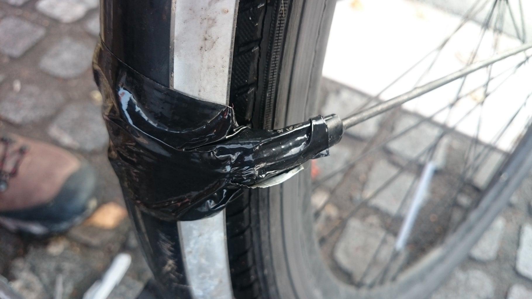 Repair Your Bike's Mudguard Holder With Duckttape