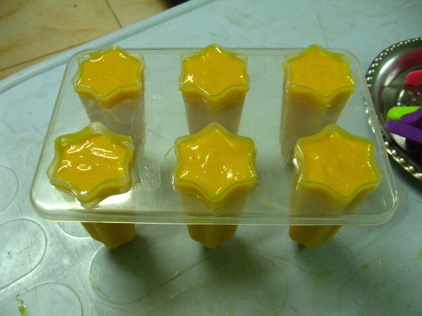 Pour Mango Cream in Popsicle Mould
