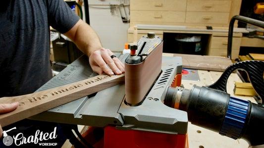 Refine Guitar Stand Shape Using Oscillating Belt Sander