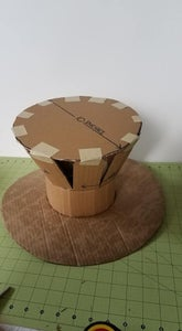 Place the 10 Inch Cardboard Circle at the Top of the Hat Body
