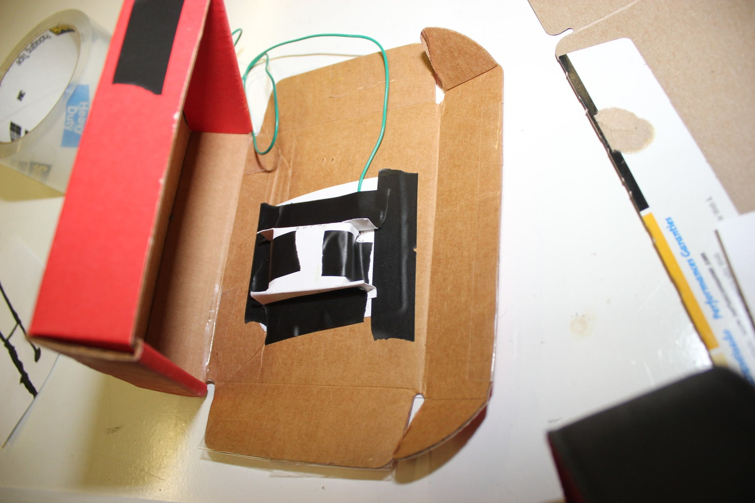 Step 007 - Tape the Box Inside the Larger Box