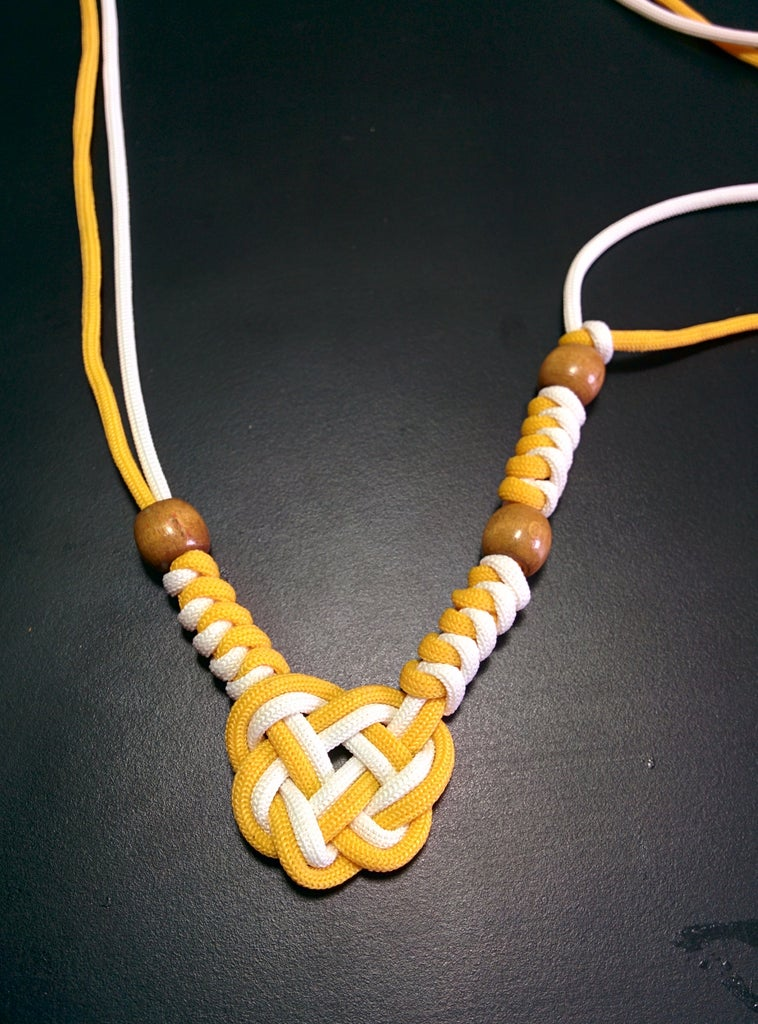 Snake Weaving the Cords With Beads