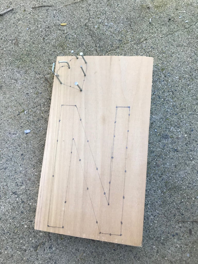 Start to Hammer Nails Into Wood