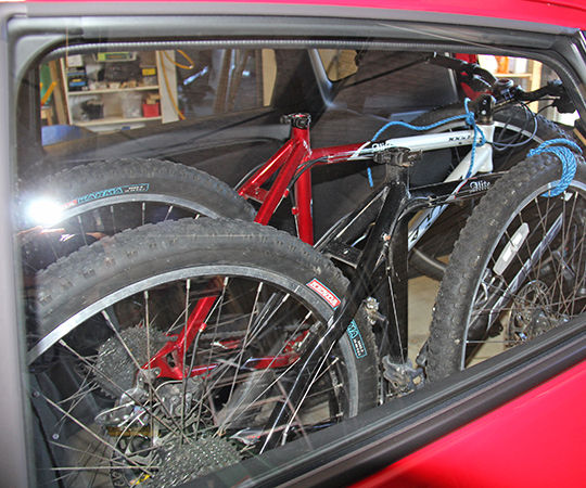 Fit two mountain bikes and two people in a 2014 Honda Jazz (Fit)