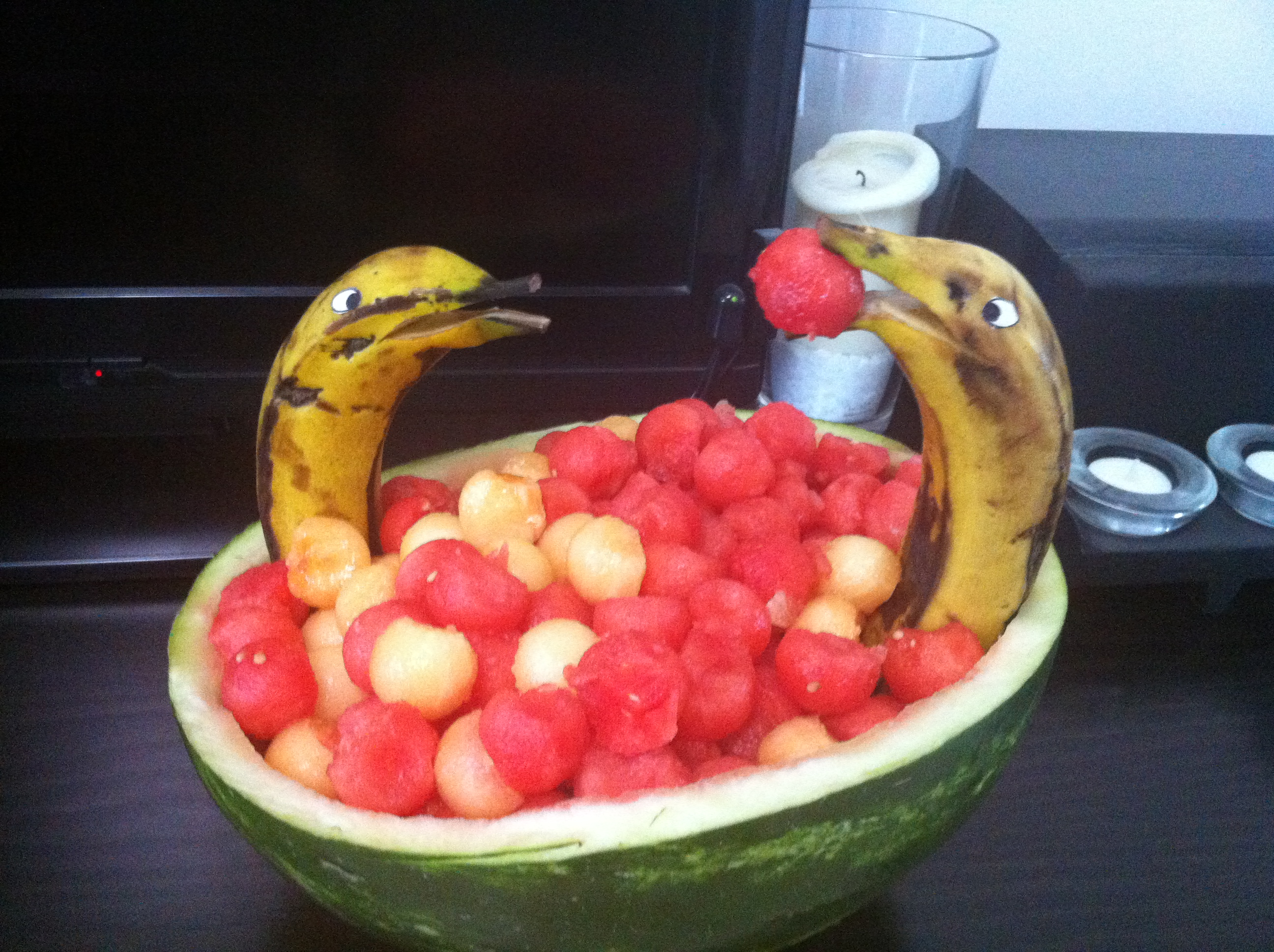 Decorated dessert - Dolphins swimming in the melons and watermelons