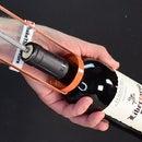 Opening a Wine Bottle With a Caulk Gun