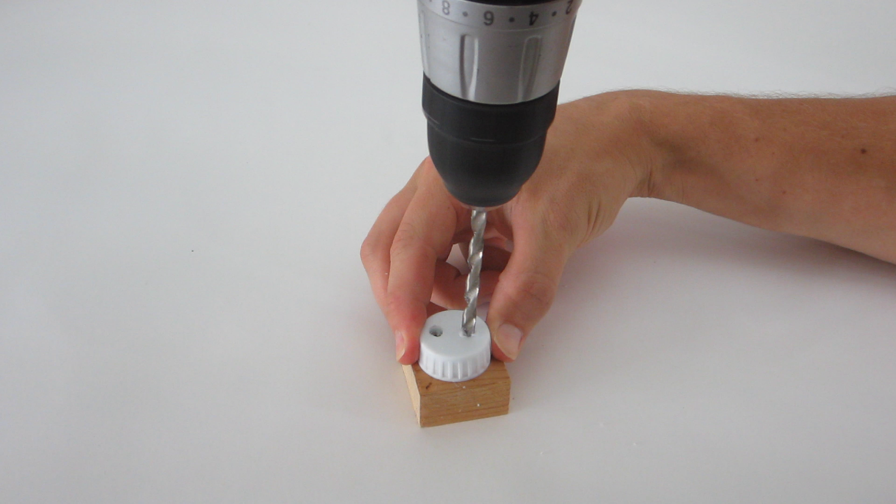 Drill Holes in the Cap of the Soda Bottle