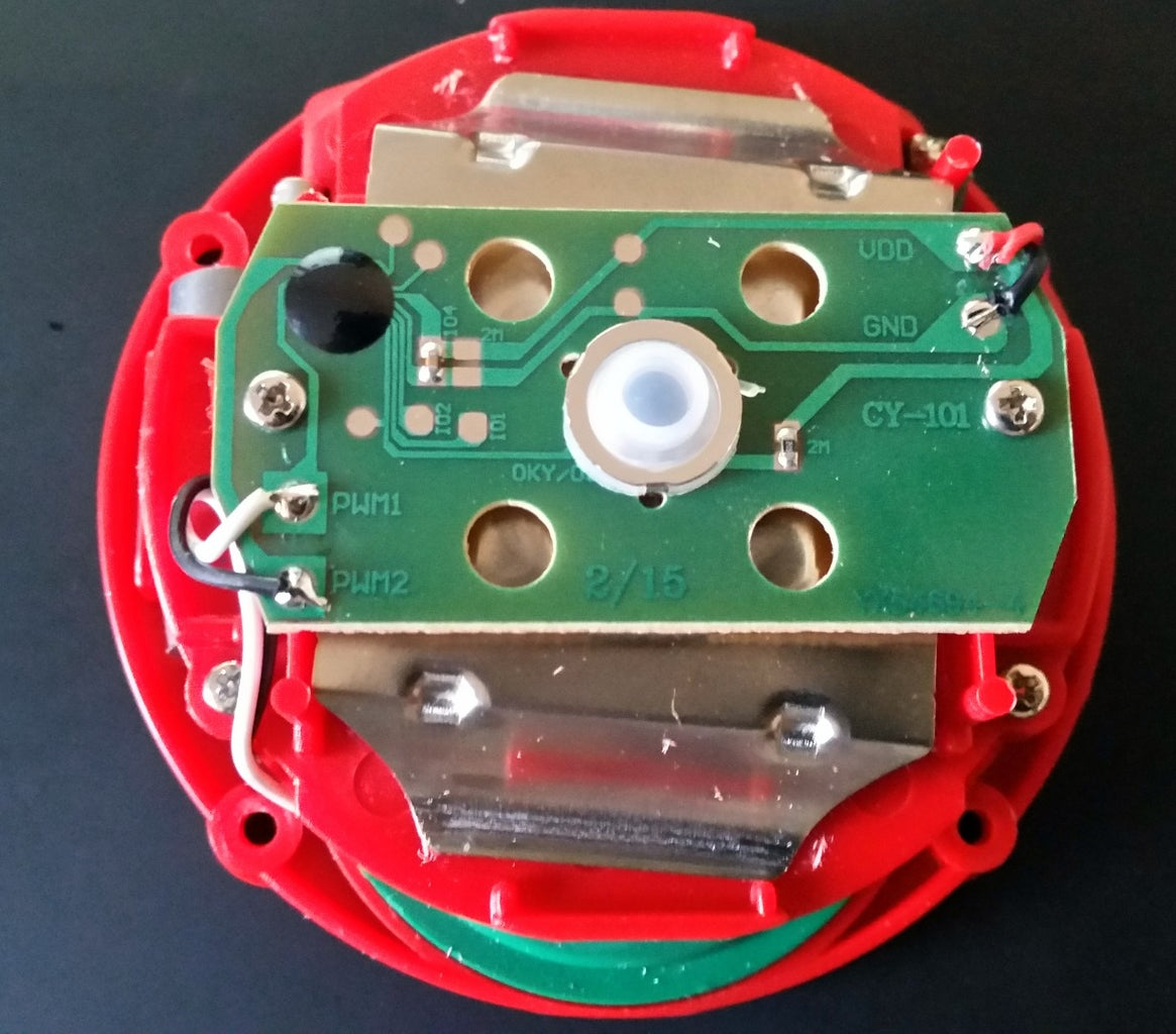 Disassembly of the Button and Observation of the Internal Circuitry