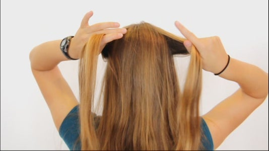 Get a Bit of Hair From Each Side of Your Head