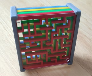 Stacked Ball-in-the-Maze Puzzles