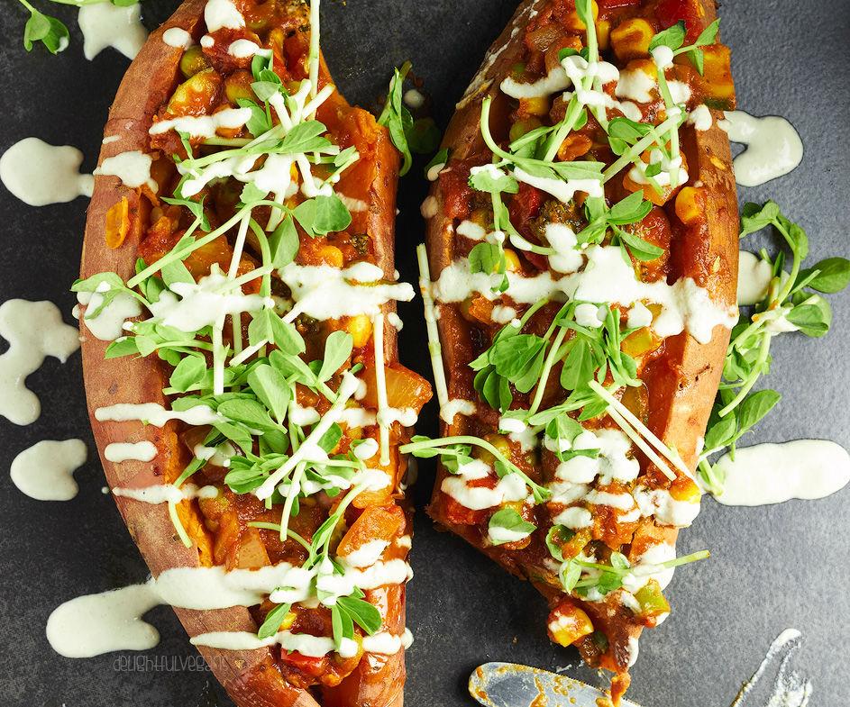 Korma Stuffed Sweet Potatoes With a Garlic Tahini Dressing