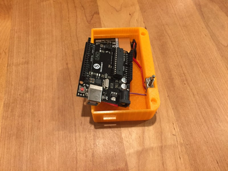 Insert the Arduino and Battery Into the Case