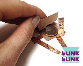 Place the Battery Inside of the Cardboard Holder!