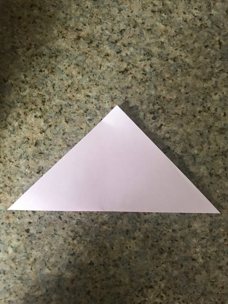 Fold the Piece of Origami Paper Into a Triangle. Do This Twice So You Have a Square.