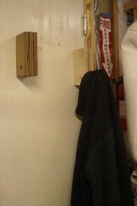 Fold Down Hanger for Coats, Cords, Etc.