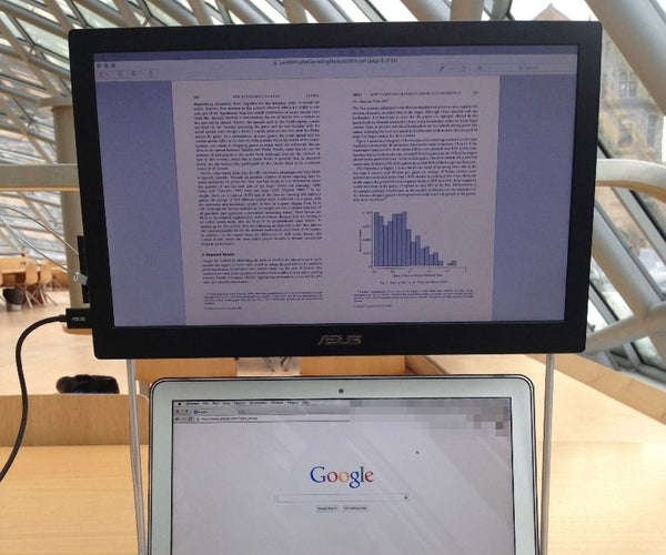 Secured MacBook Air With Portable External Monitor