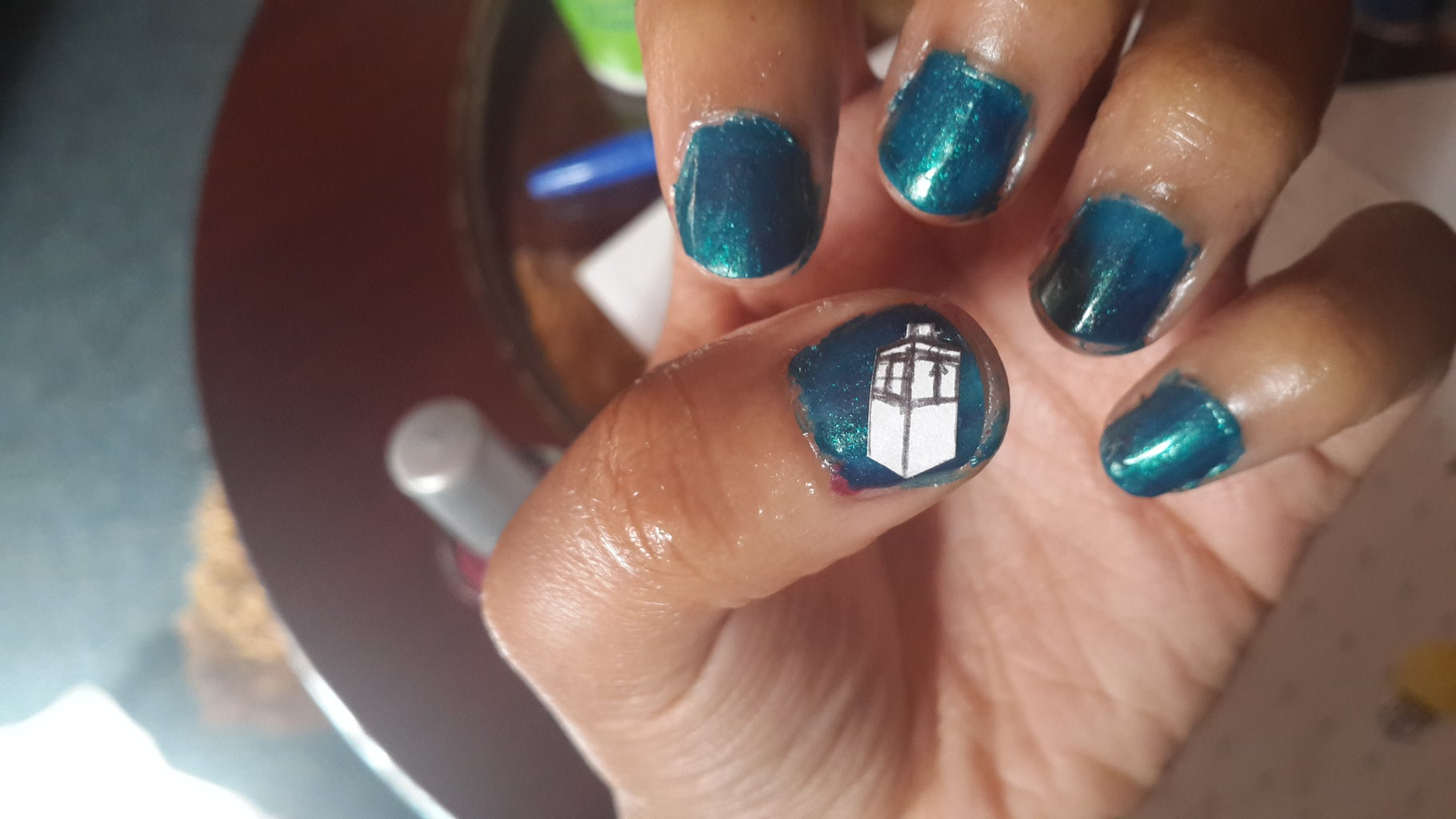 Cut Out Your Chosen Design and Stick It on the Nail