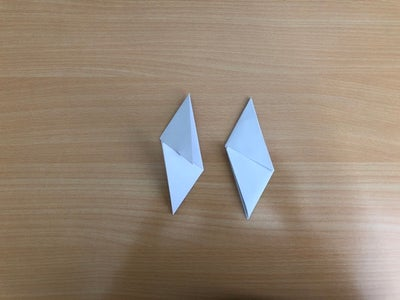 Fold Bottom and Top Triangle Pieces Inward