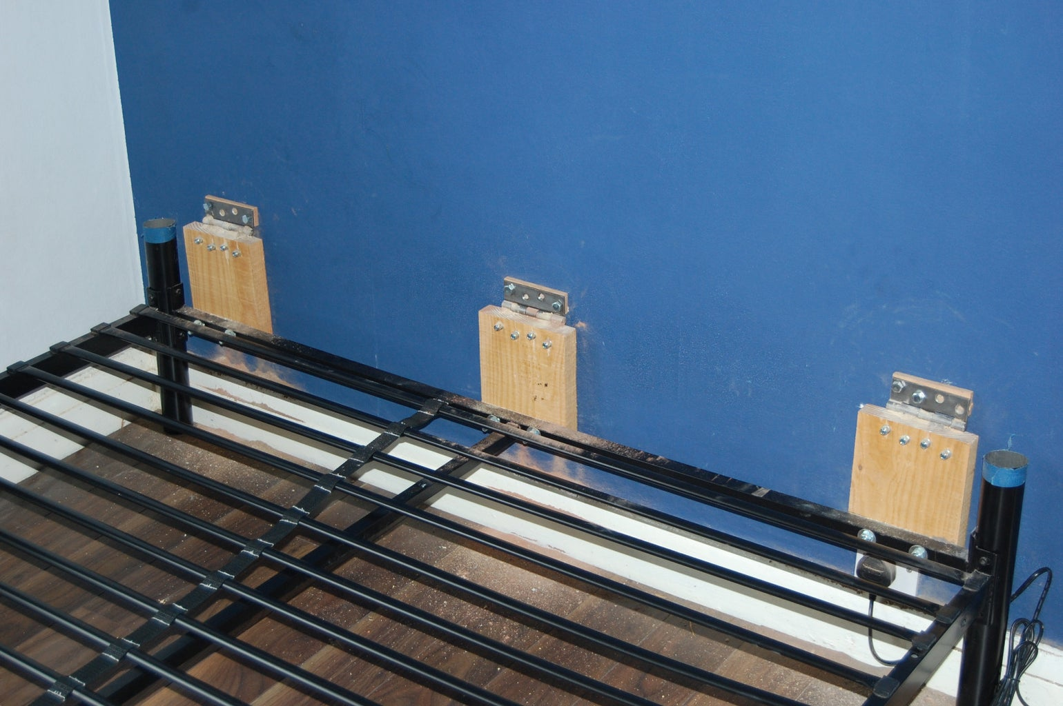 Attach Hinges to Bed and Wall
