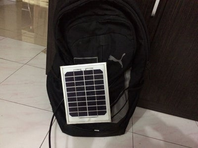 Step 2: Attach the Solar Panel to the Backpack..