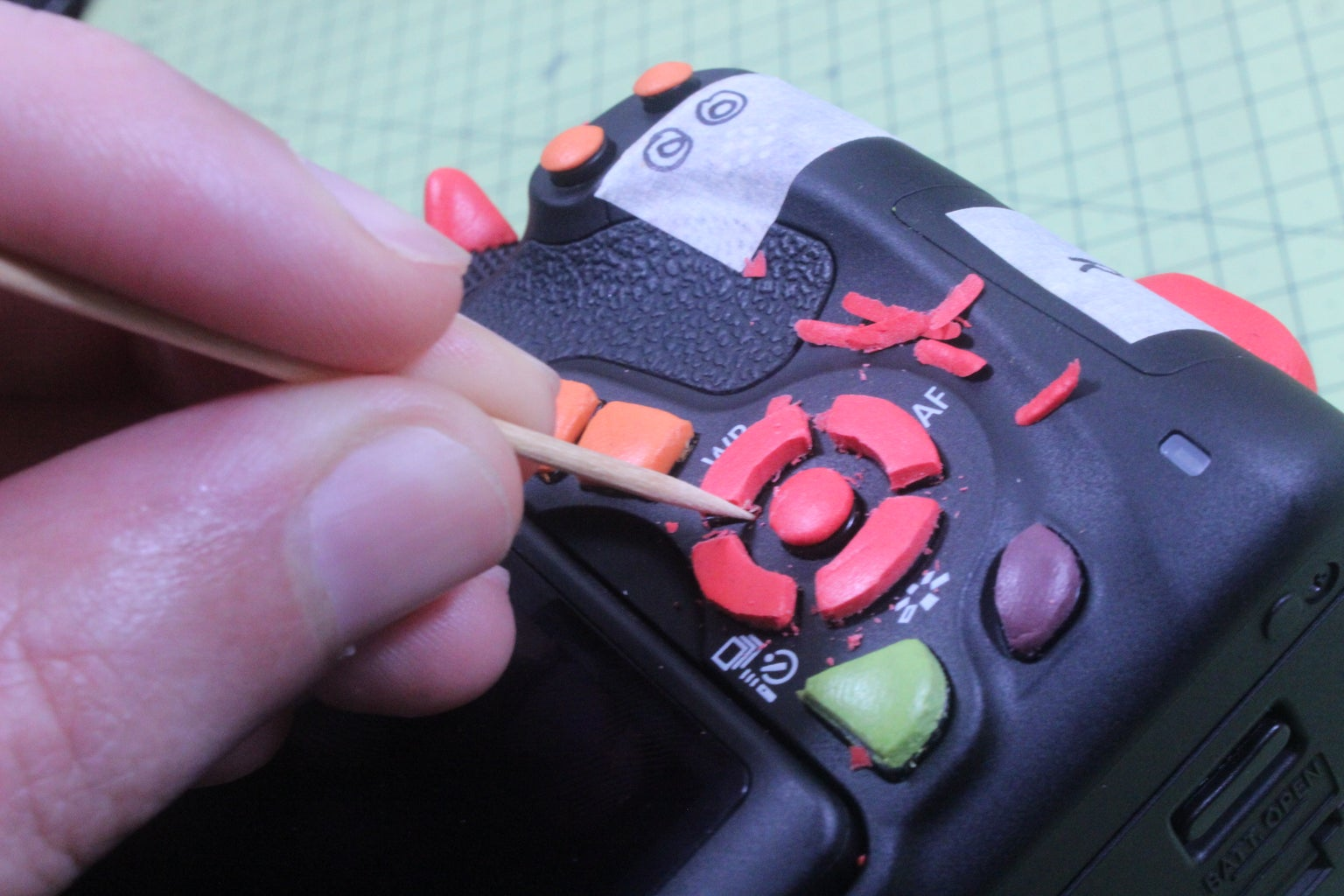 Adjusting Button Shape (Cured Sugru)