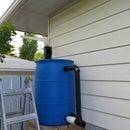 Gravity feed rain barrel garden watering