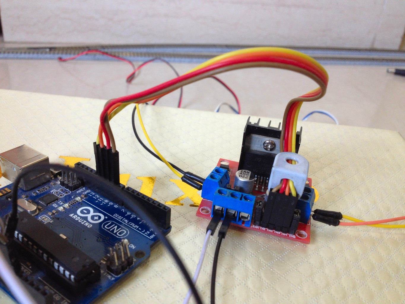 Connect the Input Pins of the Motor Driver to the Arduino Board