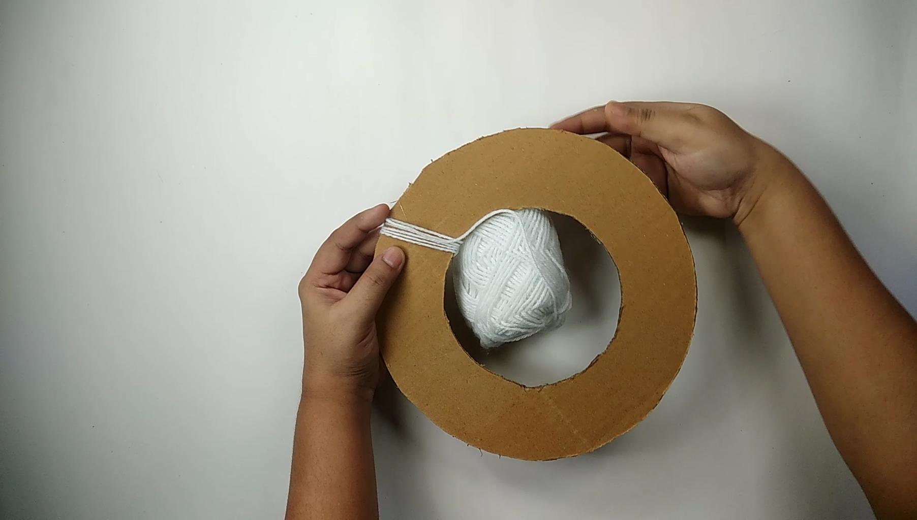 Preparing the Base With Woolen Thread