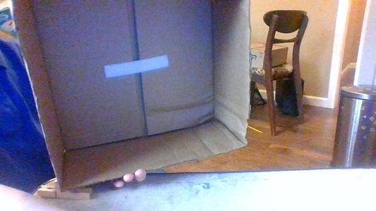 Attach the Tupperware to the Box