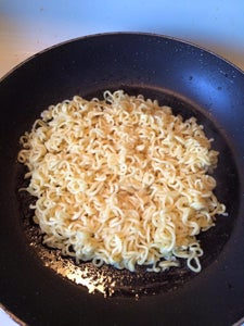 Heat Up Your Non-stick Pan Over Medium Heat and Add Some Vegetable Oil. Place Dried Noodles on the Pan
