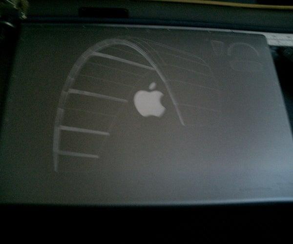 Laser Etching Macintosh Powerbooks.