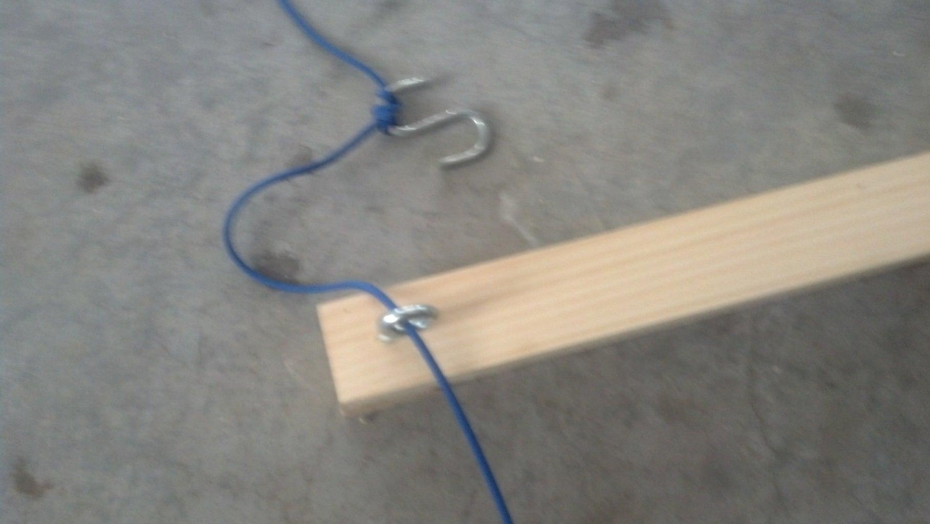 Thread the Paracord Through Eye Screw and Tie an Anchor Loop