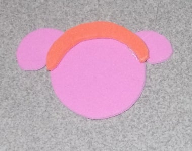 Use the Glue-gun to Glue the Headband on the Head.