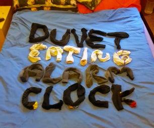 Duvet Eating Alarm Clock