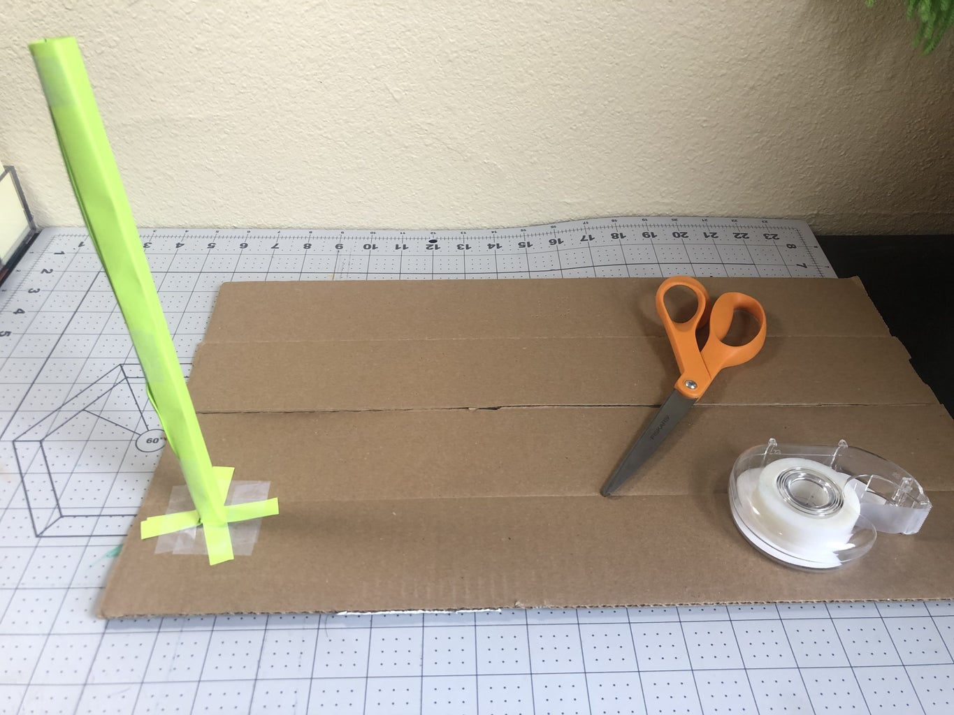 Tape Supports to a Cardboard Base