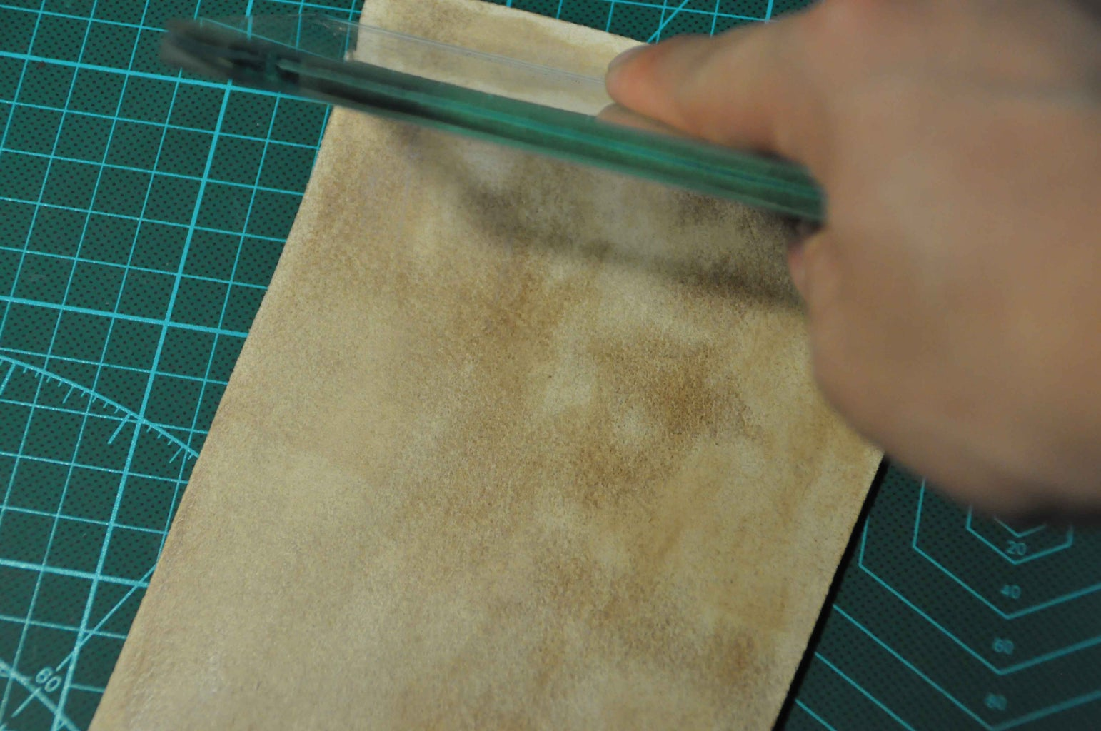Paint Leather Treatment on the Flesh Side, Smooth With a Piece of Glass Board, and Dry It With an Air Dryer.