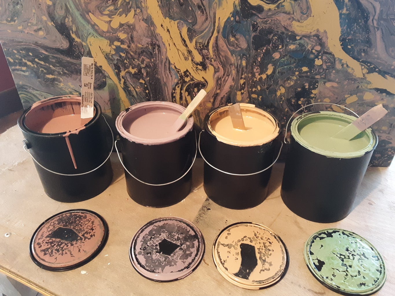 Mix Pouring Colors With Floetrol in Four Separate Containers.  (I Am Adding Black Paint)