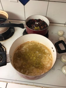 Add Flour/sour Cream Mixture, 1 3/4 Cups Chicken Broth, and 4 Ounces Canned Diced Green Chili Peppers to Onion Mixture From Step 3