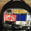 Customizable aluminium grid organizer backpack insert