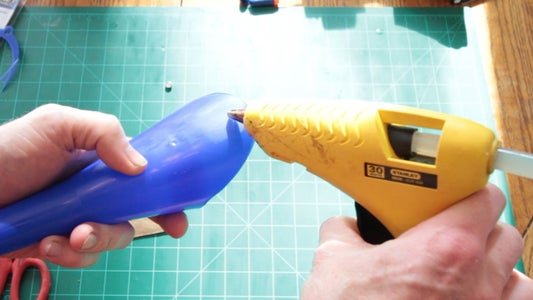 Hot Glue the Magnet to the Funnel