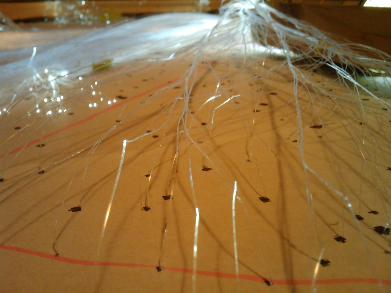 Poking Through and Gluing the Fibers