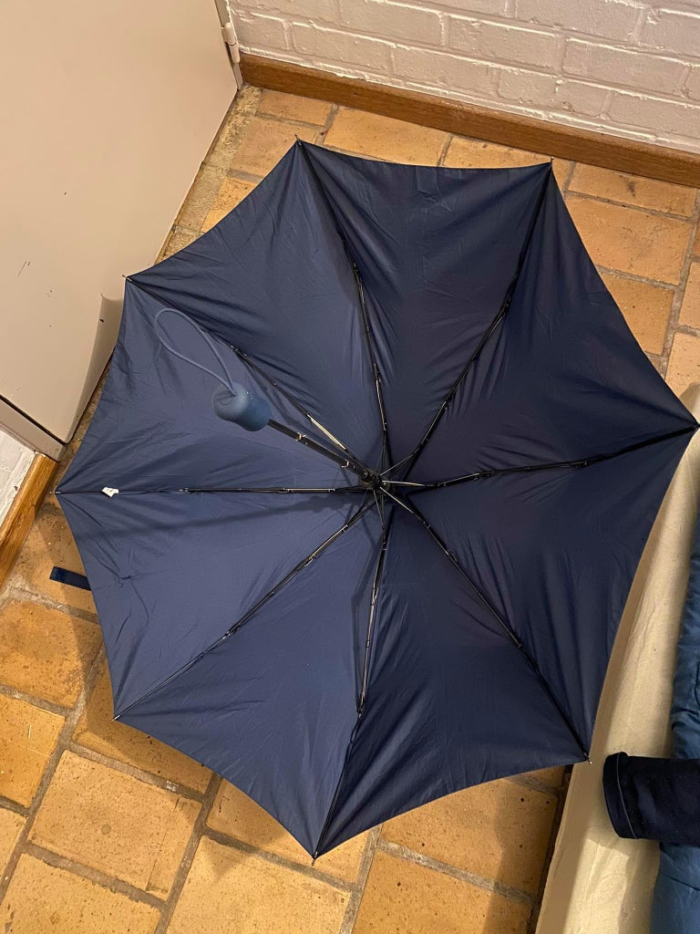 How to Turn a Broken Umbrella Into Clothes Storage Space