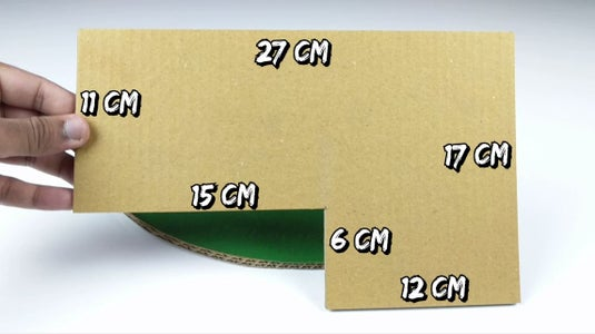Stick a Cardboard Piece on the Top of These Pencils, With Measurements As Shown in the Image.