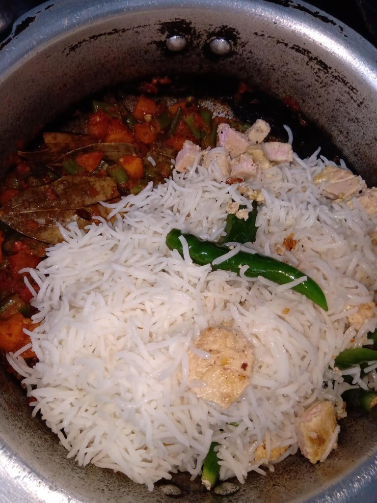 (Part 2) : to the Mixture: Add Half-boiled Rice, Green  Chillies and Fried Paneer