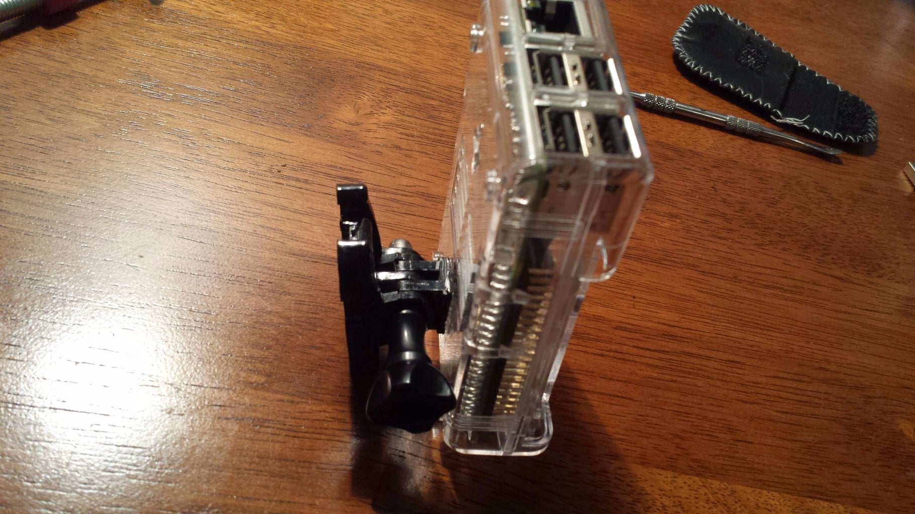 Step 5: Glue GoPro Piece to the Pi's Case