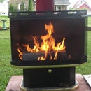 outdoor fireplace made from a reclaimed gas fireplace
