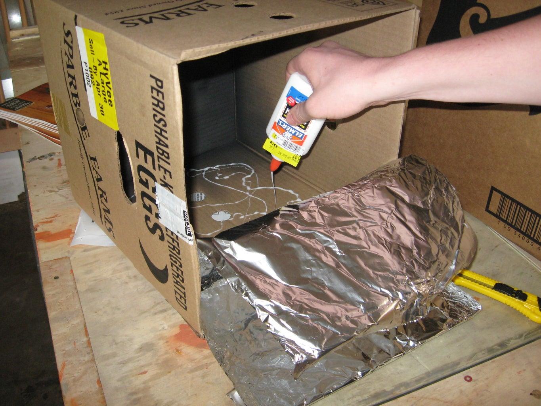 Glue Aluminum Foil on Insides of Small Box